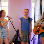 Vocal Students from World Heart Beat Music Academy in London performing for an audience