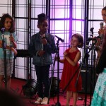 young vocal Students from World Heart Beat Music Academy in London performing for an audience