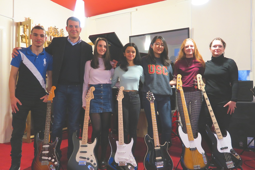 Gucci donate guitars to World Heart Beat Music Academy