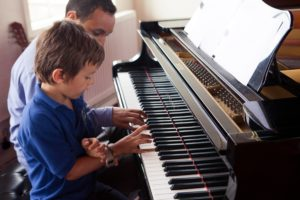 A young student enjoys Piano Lessons in Wandsworth, SW London