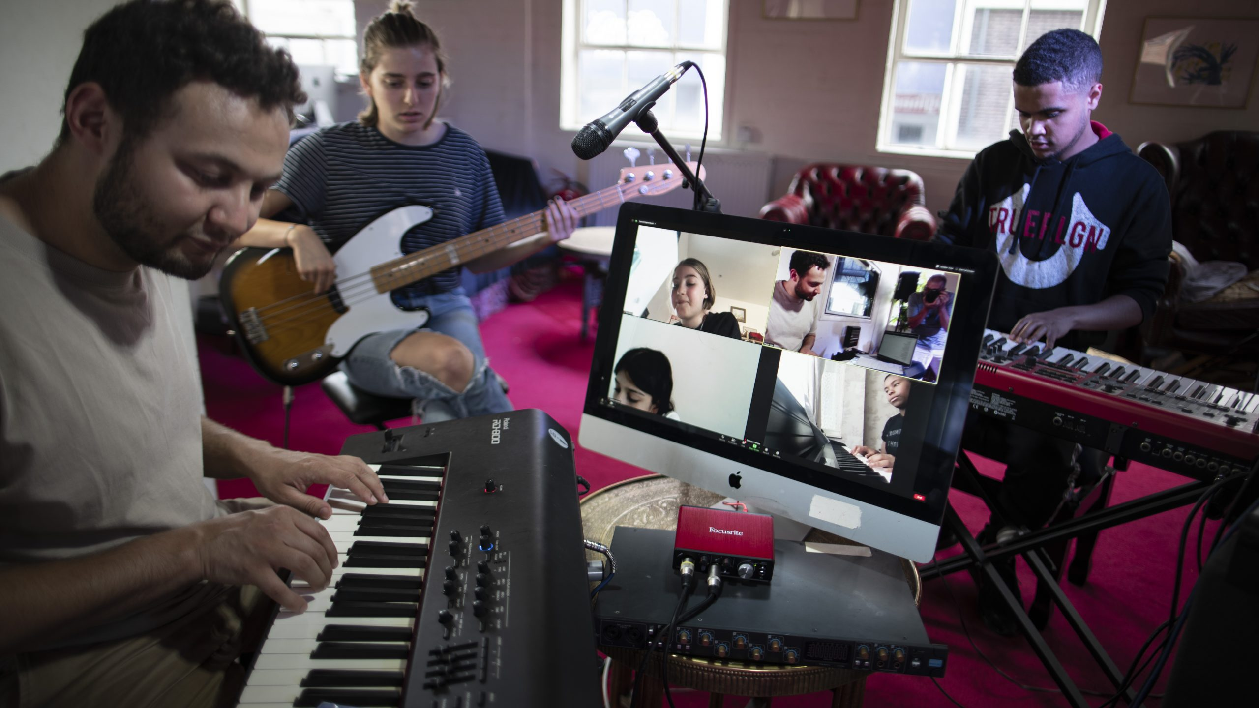 Students at World Heart Beat Music Academy using Scarlett Solo for online recording